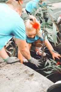Why are houseplants addictive? small girl planting a houseplant